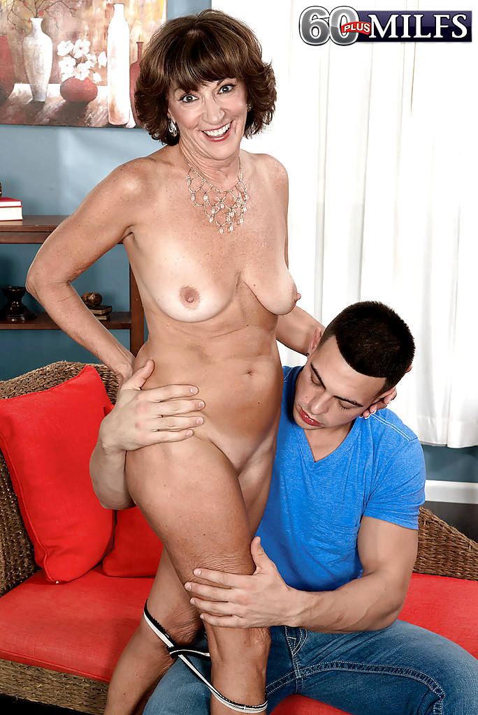 Mature lady tugs cock for cum