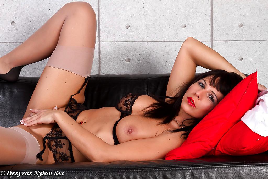 Older Brunette Milf Desyra Noir Posing In Nylons And High Heels On Bed