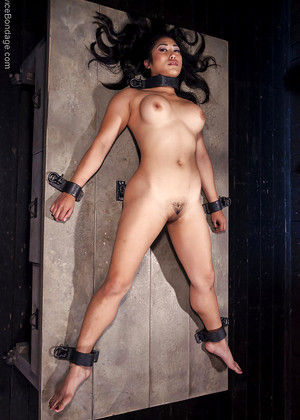 image Nicole in bondage gets spanked against brick wall