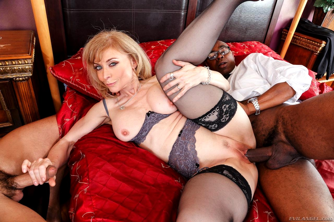 Busty granny in black stockings blowing old