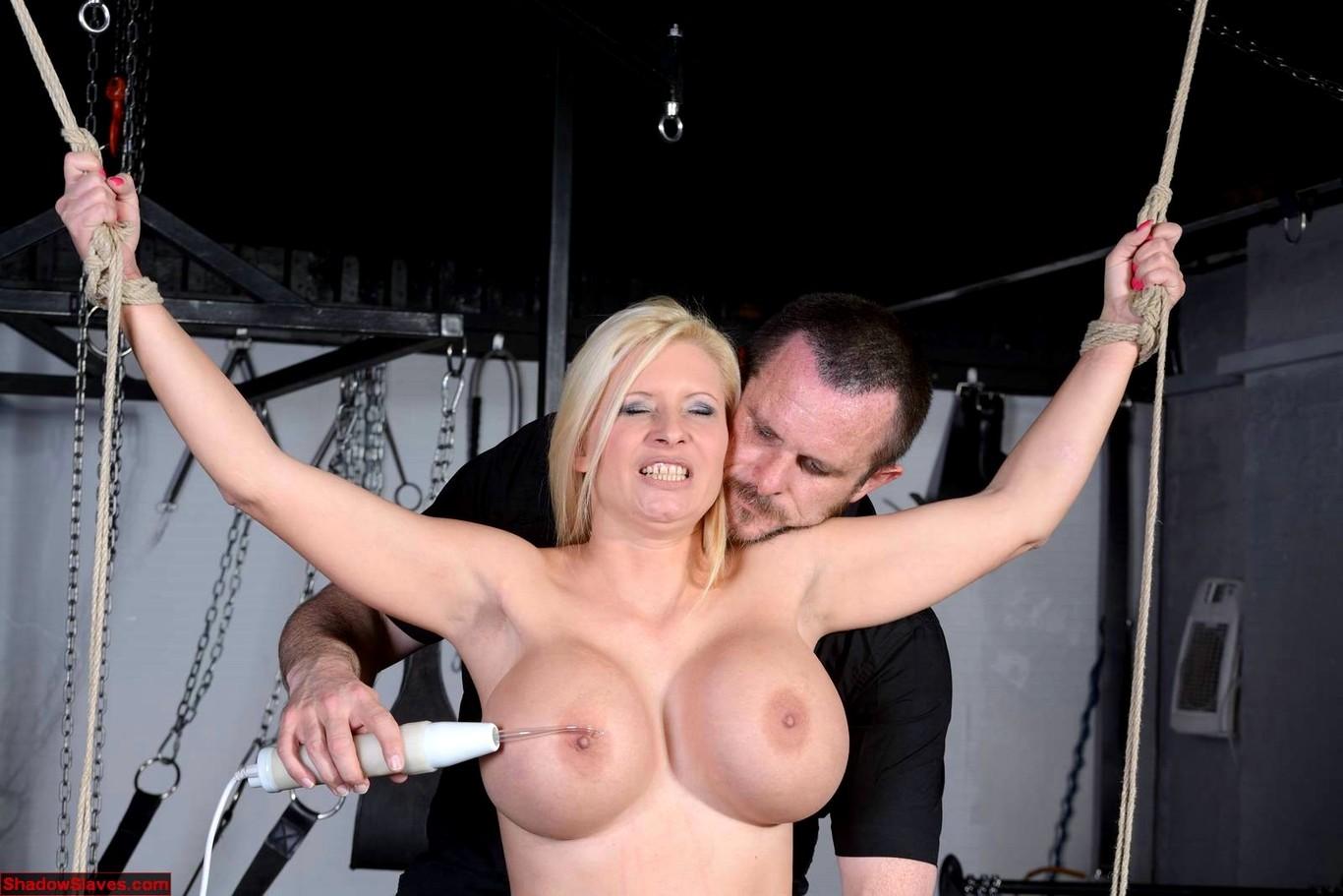 Busty BDSM sub gagson maledomsdick in trio