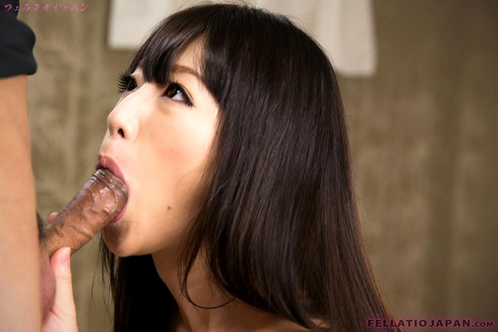Japanese girl demonstrating blowjob