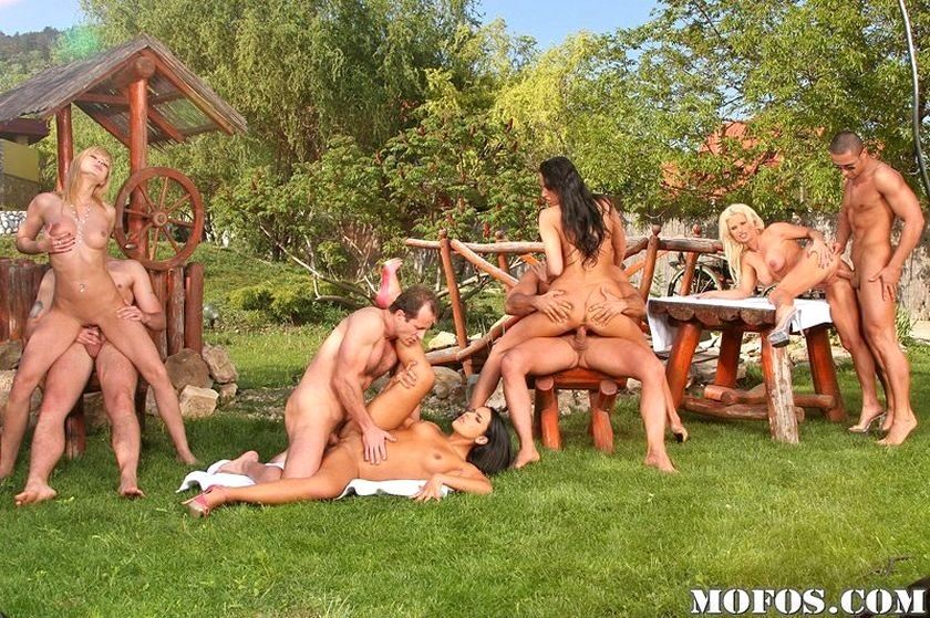 Group bisexual outdoor party