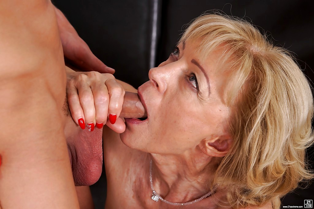 Photo of mature sucking young dick
