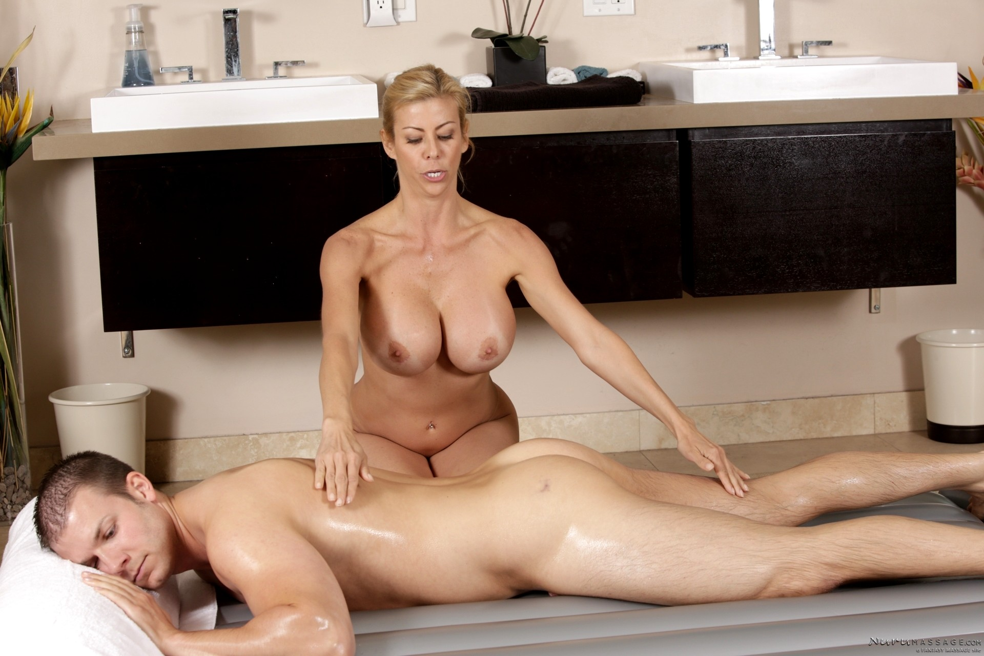 Son massages and fucks his blonde milf mom