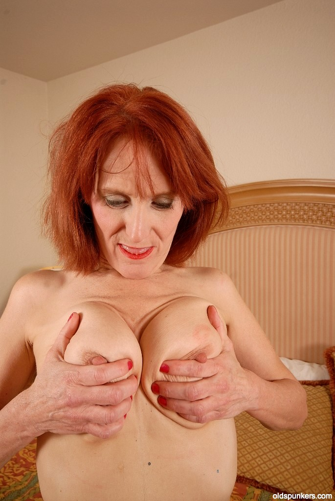 Amazing mature redhead showing her boobs teetering - 5 2