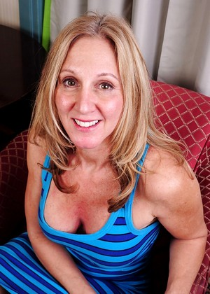 Mature 45 yo clothed woman fucks younger guy 4