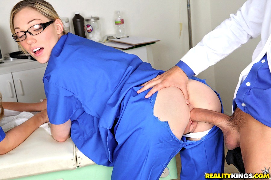 Naughty doctor fucking his kinky coworker next to a patient